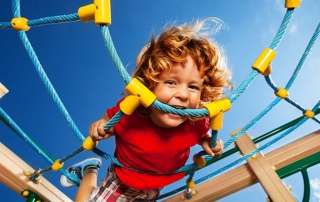 Child on play equipment