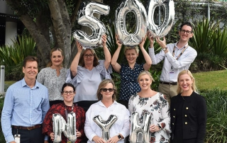 Navigate Your Health team celebrating 500th referral